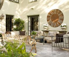 Easily blend in patio furniture to your outdoor space by opting for distressed or weathered furniture.
