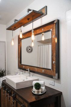 Rustic Industrial Light - Raw Steel & Barn Wood Vanity Light Specifications: - Overall Dimensions: Wide x Deep x high (w/o bulb) - Bulbs: 3 (included) - Bulb Type: Edison - 60 Watt…More 50 Easy Industrial Bathroom Decor Plans To Complement Your City Digs Rustic Bathroom Lighting, Rustic Bathroom Designs, Rustic Bathroom Vanities, Rustic Bathrooms, Rustic Lighting, Bathroom Ideas, Lighting Ideas, Industrial Bathroom Lighting, Bathroom Faucets