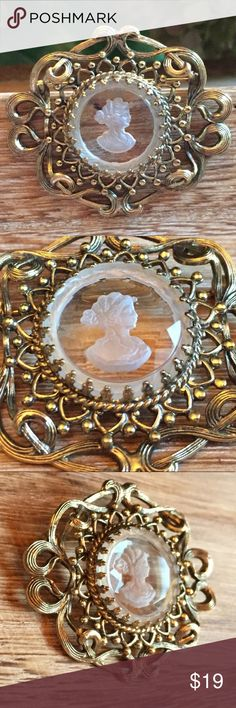Vintage Etched Glass Cameo Vintage glass etched cameo. This beautiful lady is prong set in a lightweight gold tone metal. Safety clasp back closure. Measures - 2 inches across. -  1.5 inches tall. Vintage Jewelry Brooches