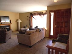 Beautiful Living Room/dining Room Combination With Fireplace And New Carpeting. New Tile Floor In Entry And Hallway.