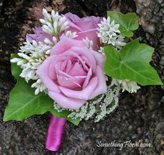This pink and white, fresh floral, spray rose boutonniere featured a prominent presence of spring green ivy. In Victorian floral language, ivy's meanings are wedded love, fidelity, friendship, and affection. #wedding #boutonniere #pink #rose #white #buttonhole #ivy #green