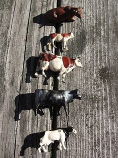 Vintage Collection of 5 painted metal cows by BarnshopAntiques on Etsy