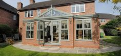 View this fabulous T-Shaped Orangery with Chartwell Green Windows & French Doors. This stunning Orangery is only a sample of the range offered by Clearview. Tiled Conservatory Roof, Modern Conservatory, Conservatory Extension, Garden Room Extensions, House Extensions, House With Porch, House Front, Orangerie Extension, Upvc French Doors