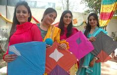ISLAMABAD: Students hold kites during Basant festival at National Textile Insinuate.