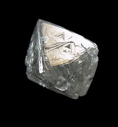 Diamond, Miba Mine, Mbuji Mayi (Bakwanga), Kasaï-Oriental, Democratic Republic of Congo (Zaïre), 10x9x9 mm. Photo Copyright © 2000-2002 by John H. Betts. All Rights Reserved. This photo, and many others, have been provided by John Betts Fine Minerals - http://www.johnbetts-fineminerals.com