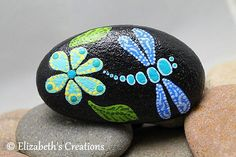 Beautiful hand painted dragonfly Mandala Stone . This stone measures approximately 3.75. x2.25. The colors are very rich and vibrant as you can see and this design is made entirely from hand painted dots.... dot by dot! Shipping is done thru USPS. I ship priority so it is a fixed