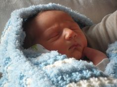 My new grandson Sammy - and his blanket that I made for him!