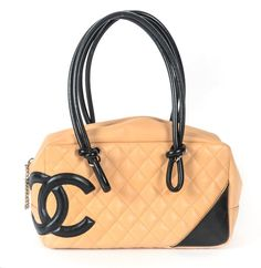 Chanel Ligne Cambon Bowler Shoulder Bag. Get one of the hottest styles of the season! The Chanel Ligne Cambon Bowler Shoulder Bag is a top 10 member favorite on Tradesy. Save on yours before they're sold out!