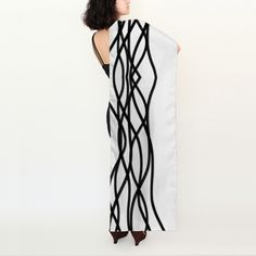 Fantastic and elegant black and white silk scarf.