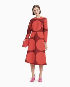 The Honka dress is made of cotton in the Kivet (stones) pattern. The dress has a concealed zipper in the back seam and fitted sleeves with darts at the elbows. There is a horizontal seam at the waistline and the A-line skirt has an asymmetrical cut. Normal Body, Coat Dress, Dress Red, Marimekko, Long Toes, Clothes For Sale, Dark Red, A Line Skirts, Designer Dresses
