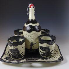 "Fylfisher Decanter Set  One liter decanter(11""h x 4""w), 300 ml tumblers (4""h x 3.5""w), and platter (13""l x 13""w x 1""h). Cone 6 stoneware, electric oxidation. $280."