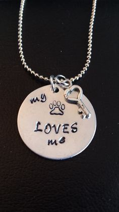 My pet loves me. Can also add another charm with your pet's name.