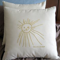 julie-k | embroidered sun pillow . Here's a cool idea- embroider some of your little one's best works onto pillows or blankets to decorate with