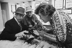 """The """"Good Food"""" Movement: in the 1970s, American chefs turned to Europe for inspiration in using local, artisanal produce. Image: Julia and Paul Child (center) examining lobsters at a Boston market in 1975 with characteristic care."""