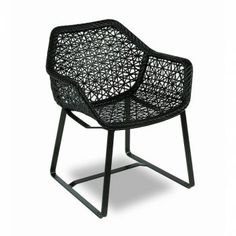 Maia Dining Armchair by Kettal. This product was used in the Openwork collection photography.