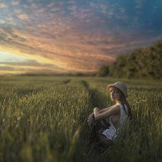 yong girl in the field by David Dubnitskiy