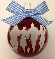 I made this ornament for my friend, Jennifer :) --She's a Wizard of Oz fan too!! :) :) I used clear ornament, glitter, vinyl and my silhouette cameo machine :)
