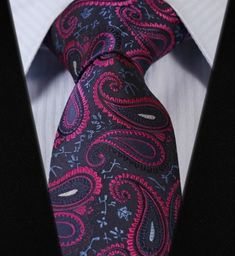"""Product number: PA-5778 Length: 57"""" Width: 3.25"""" Material: 100% Silk Care: Dry Clean Only Label: D&T This is a fun but classy, navy and fuscia pink paisley tie. Looks like the paisleys are dancing! Pu"""