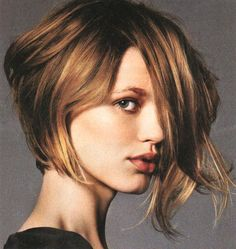 I want to cut my hair like this but my face is really round and I don't know if I could pull it off. short asymmetrical wavy hairstyle