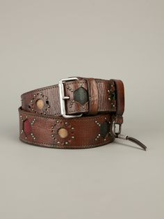 Brown leather belt from Dukes featuring a silver-tone buckle fastening, a leather tassel hanging from a silver-tone ring to the front as a design detail, cut details around the belt to reveal contrasting green, yellow and red leather panels and gold-tone stud detailing.