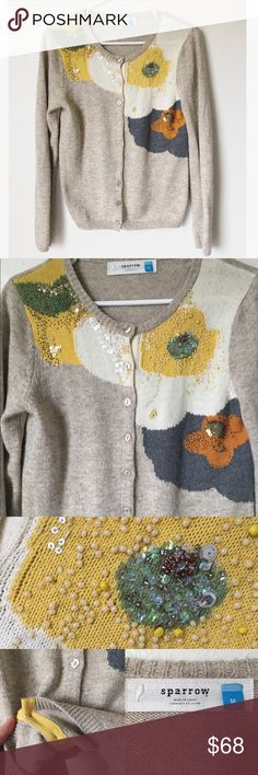 Anthropologie Sparrow Carlotta Cardigan Sold out unique cardigan featuring a tan body and shoulder detailing with bright colors and intricate beading. Great condition very minor gap near one of the beads in image otherwise looks nearly new. Anthropologie Sweaters Cardigans