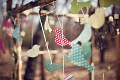 Love Birds {DIY Tip} Gather a collection of different pretty cardboard or sturdy paper and using a stencil or bird template, cut out bird-shapes. Punch a hole in the shoulder area of each bird and string it along a line.