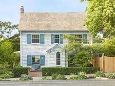 I love the colors of this house!  Curb Appeal and Landscaping Ideas From Across the Country | Landscaping Ideas and Hardscape Design | HGTV