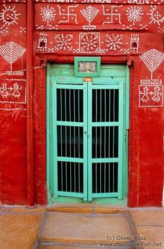 Spectacular contrast between a turquoise door and a red surround in India.  Love this contrast