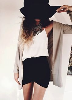 Black mini skirt, white shirt, silver statement necklace, beige jacket and black hat