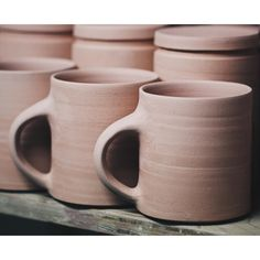 A board of mugs and storage jars in their bisque fired state. Fundamentally basic in design with an emphasis on comfort and practicality. The throwing of these couldnt be more straightforward. Apart from the fact theyre made quite finely its more or less a straight cylinder with a slightly beveled rim. I use a rather thick straight edge metal kidney to push the clay against while throwing. Making sure to leave some quality of the making process apparent such as the throwing rings on the…