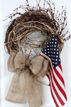 Primitive Patriotic Front Door Wreath, Americana, Burlap Bow, Pip Berries, Aged Flag, 4th of July Wreath, Country Wreath -- FREE SHIPPING. $115.00, via Etsy.