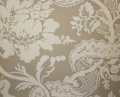 Versailles Wallpaper An elegant damask style wallpaper printed in light cream on a beige background.