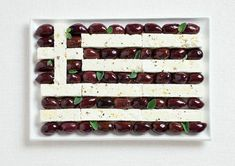 greece flag made from food/Kalamata Olives and feta cheese