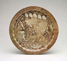 Plate  December 1210    Shamsuddin al-Hasani Abu Zayd , (Iranian,  Saljuq period    Stone-paste painted over glaze with luster  H: 3.7 W: 35.2 D: 35.2 cm  Kashan, Iran