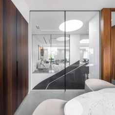 Penthouse : Fashionable Penthouse Interior Design in London By Fernanda Marques Arquitetos Associados - London Penthouse Room View with Huge Glass Wall and Black Stair in The Center By Fernanda Marques Arquitetos Associados medium version