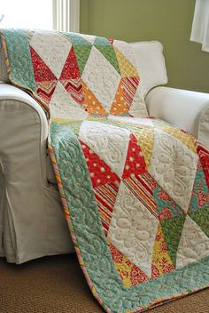 i love the modern blocking combined with the feminine quilting on this! Beautiful colors too!