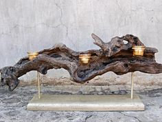Nature-Inspired Candleholder This wood candleholder from db Sources is a great addition to any outdoor room. Add candles to any outdoor space to create a serene environment and soft lighting come nightfall. Driftwood Furniture, Driftwood Lamp, Driftwood Projects, Driftwood Sculpture, Wood Lamps, Driftwood Candle Holders, Votive Holder, Outdoor Candles, Into The Woods