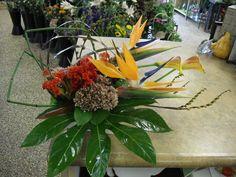 Orange , green flower arrangement for wedding and events