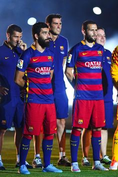 Arda Turan (L) and Aleix Vidal of FC Barcelona look on during the team official presentation ahead of the Joan Gamper trophy match at Camp Nou on August 5, 2015 in Barcelona, Catalonia.
