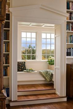 Steps up to a window seat reading nook.Window seat room behind built in book shelves. From Houzz: Carve out a neat little nook. Sweet Home, Home Libraries, Cozy Nook, Cozy Corner, My New Room, Design Case, Design Design, Design Ideas, Design Inspiration