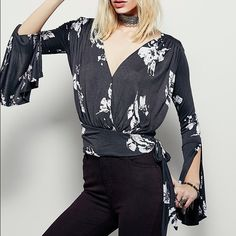 """Free People Fiona Top size XS Gorgeous EUC Free People Fiona Too, size XS, in color """"coal combo"""". Deep v-neck with a side tie accent at waist. Billowy open bell sleeves and flowy material. Perfect to dress up or down. Make me an offer!! Free People Tops Tees - Long Sleeve"""