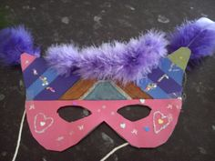 A creative mask made with pens....glitter glue...card ...feathers..sellotape....string and sequins easy and fun to make