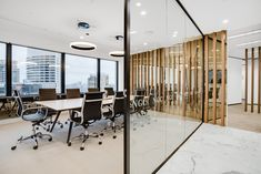 Combination of Timber and Glass creating a modern boardroom interior