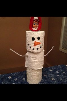 Elf on the Shelf in a snowman made of toilet paper rolls….