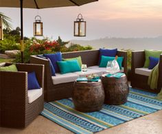 Perfect setting for sunsets: Our modular, sophisticated Ciudad Seating Collection in all-weather wicker