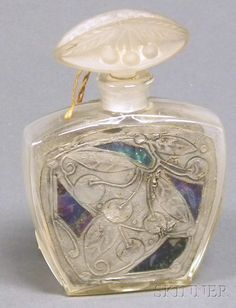 Art Nouveau Perfume Bottle. Molded glass stopper on colorless glass bottle with cherries and leaves in silver with geometric mother-of-pearl inlay accents in the surround, marked AF in the metal on base