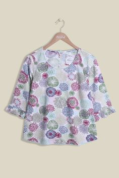 Our 100% cotton Flower Seed Top is cut to a relaxed fit, perfect for those summery months. The lightweight floral print combined light and bolder colours, creating the perfect bright and cheerful top. Featuring a scoop neckline, lace hemming and frilled 3/4 length sleeves.