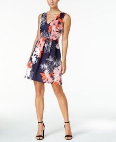 Vince Camuto's floral-print scuba dress is like an instant refresh for your wardrobe in a feminine silhouette that looks great with heels. | Polyester/spandex; lining: polyester | Dry clean | Imported