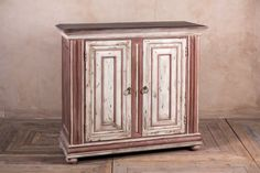 Introducing this shabby chic cabinet from our new collection of hand-finished furniture. This red and cream cupboard could be used as a small sideboard...