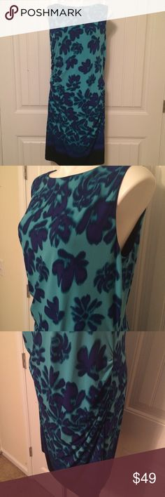 Turquoise floral dress Turquoise & lapis blue floral print, trimmed in navy, dress.   Fitted on the body, with gathers on both sides. Zips up the back. Just above the knee. NWT Carmen Marc Valvo Dresses